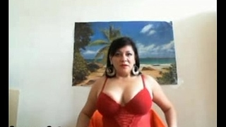 Big breasted MILF stripping and teasing