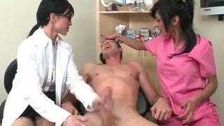 Hot brunette female doctor stroking